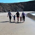 Family at Cooks Beach, photo by Tony Applegarth