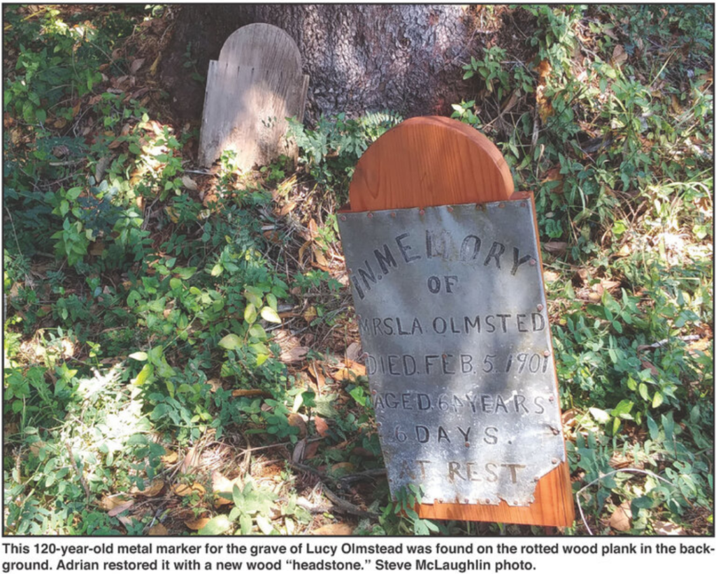 """This 120-year-old metal marker for the grave of Lucy Olmstead was found on the rotted wood plank in the background.  Adrian restored it with new wood """"headstone."""" Steve McLaughlin photo."""