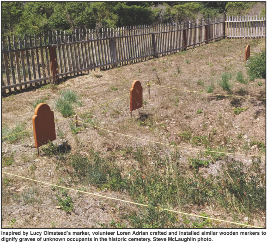 Inspired by Lucy Olmstead's marker, volunteer Loren Adrian crafted and installed similar wooden markers to dignity graves of unknown occupants in the historic cemetery. Steve McLaughlin photo.